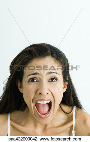 Stock Photo of Woman screaming, looking at camera, head and.
