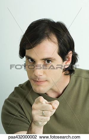Stock Photo of Man, pointing at camera, head and shoulders.