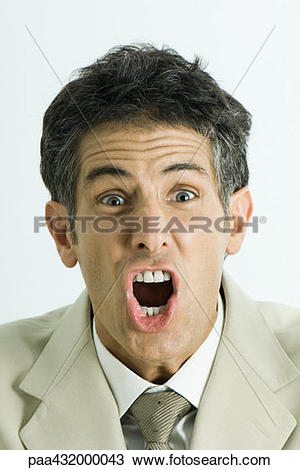 Stock Photo of Man screaming, looking at camera, head and.