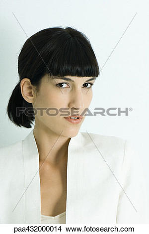 Stock Photo of Woman, giving camera sideways glance, head and.