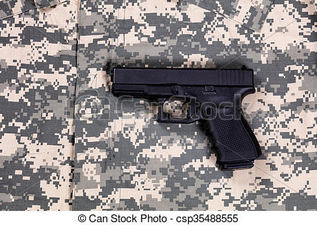 Stock Images of Camouflage battle dress uniform with weapon.