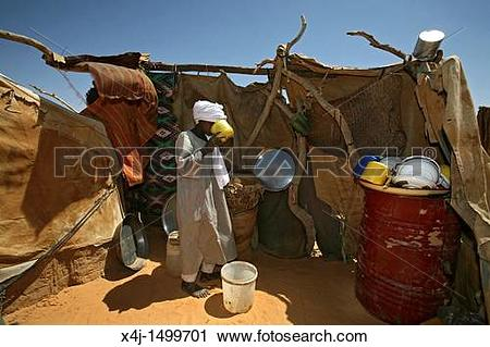 Stock Photography of water well in a sudanese refugee camp in Chad.