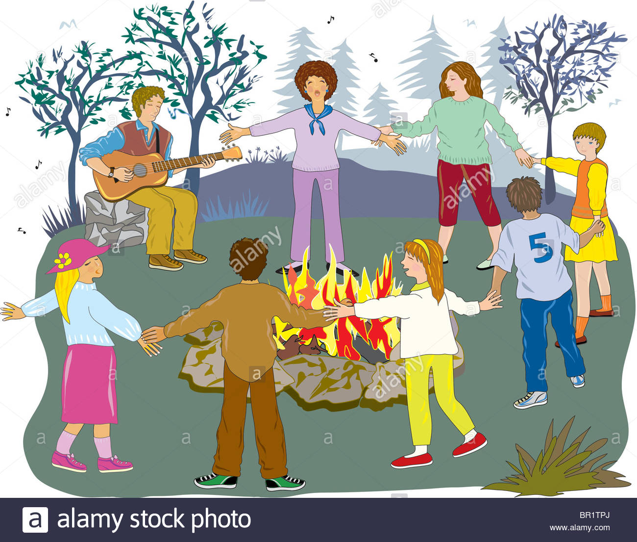 A group of friends holding hands around a campfire Stock Photo.