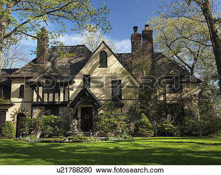 Stock Photography of Beautiful family house springtime scenery.