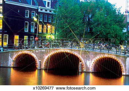 Picture of Canal bridge lit up at night, Amsterdam, Netherlands.