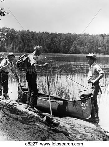 Picture of 1930S 3 Men Standing Beside Canoe On Lake Holding.