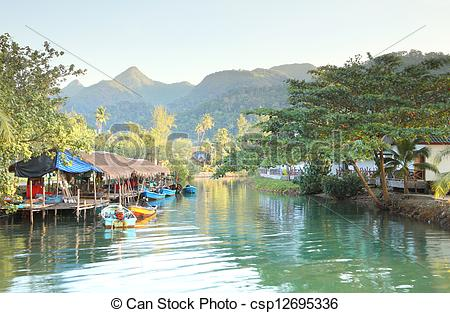Stock Photos of Tropical fishing house villager canal and some.