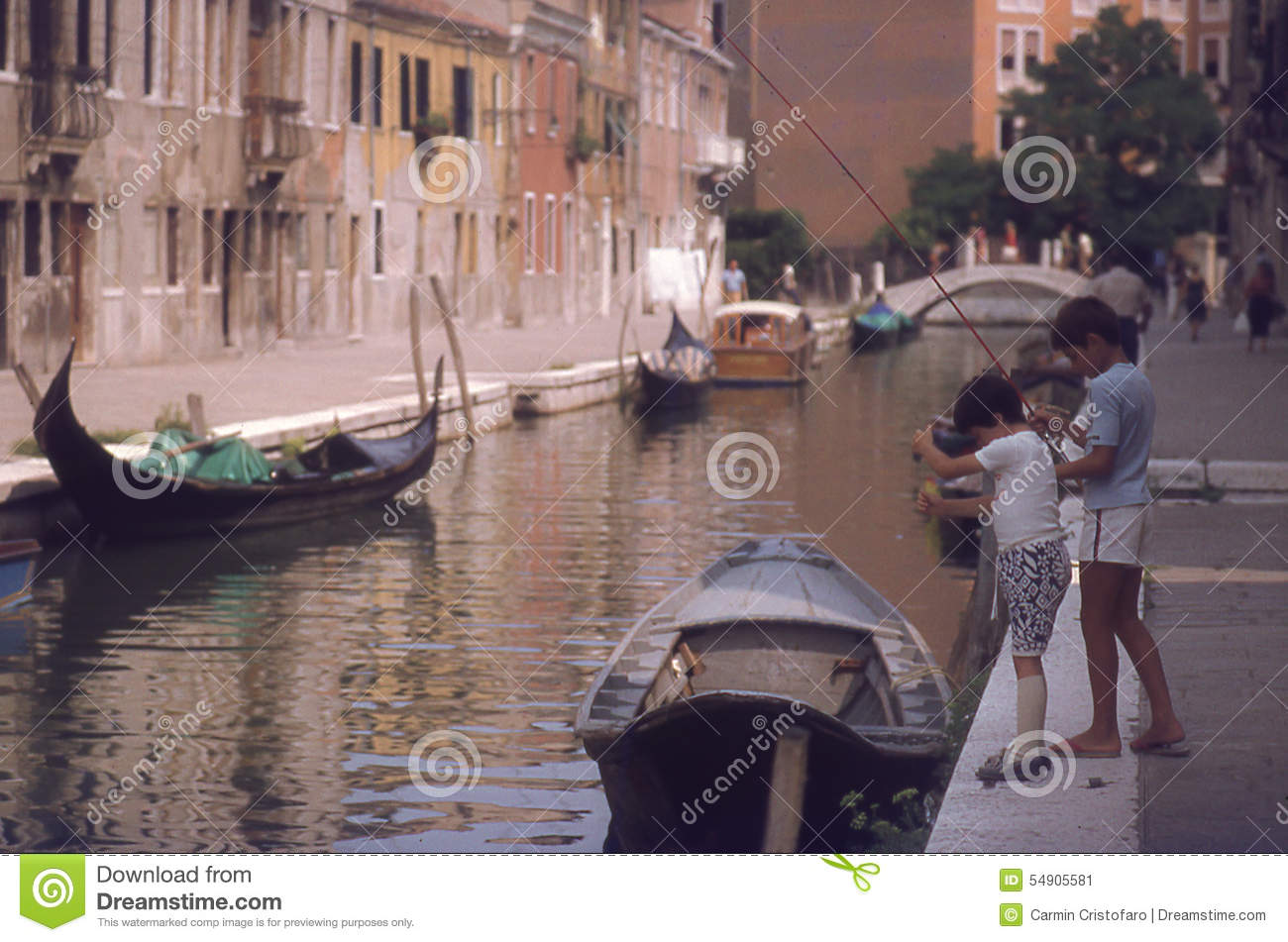 Children Fishing In Canal In Venice Editorial Photo.