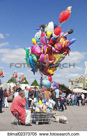 "Stock Image of ""Trader selling balloons, Cannstatter Wasen."