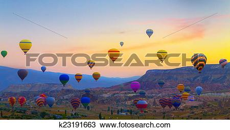 Stock Photo of Hot air balloons sunset Cappadocia, Turkey.