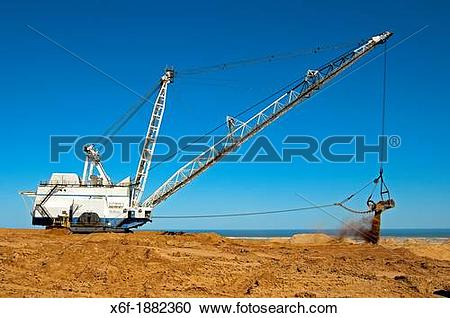 Stock Photography of Dragline excavator handling overburden at the.