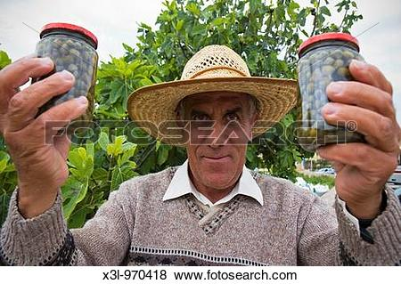 Pictures of Farmer showing capers Gozo island Malta x3l.