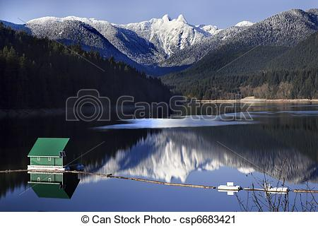 Stock Photography of Capilano Reservoir Lake Green Building Dam.
