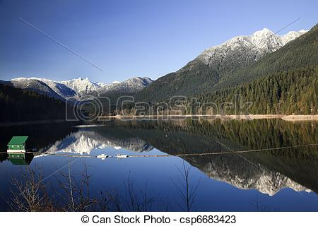 Stock Photos of Capilano Reservoir Lake Long Reflection Green.