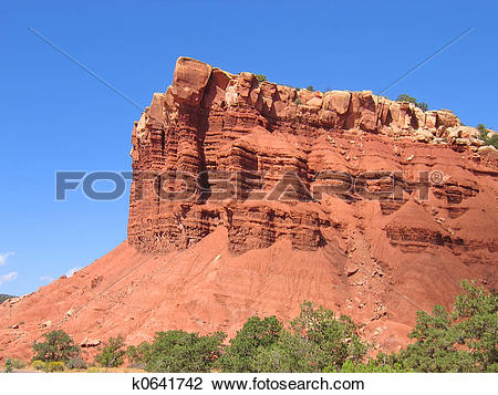 Stock Photo of Red cliff mountains with strange pattern, Capitol.