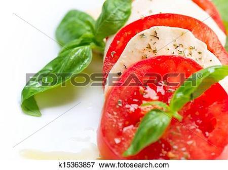 Picture of Caprese Salad. Tomato and Mozzarella slices with basil.