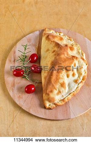 Stock Photo of Calzone caprese (a pizza pocket filled with.