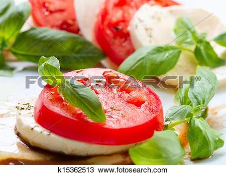 Stock Photo of Caprese Salad. Tomato and Mozzarella slices with.