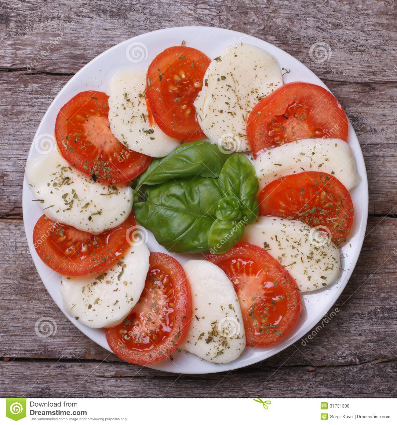 Caprese Salad On An Old Wooden Table. Close Up. Top View Stock.