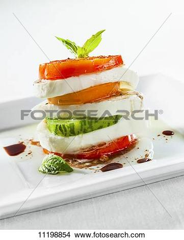 Stock Photo of Stacked Caprese Salad with Fresh Mozzarella.