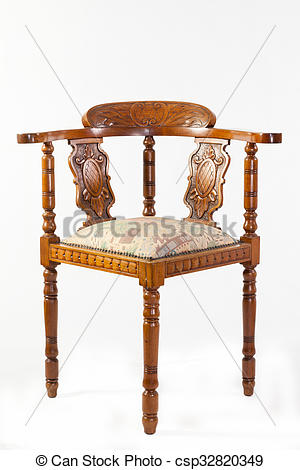 Stock Photo of Antique fruitwood Captains chair or corner chair.