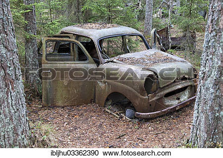 "Stock Photography of ""Old car wreck in the car cemetery of Kyrkoe."