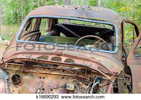 Stock Photo of The old car cemetery k16690293.
