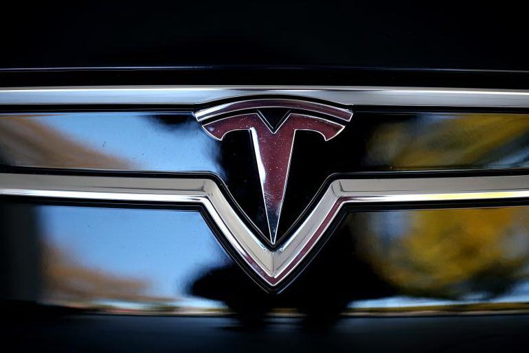Tesla Logo, Tesla Car Symbol Meaning and History.