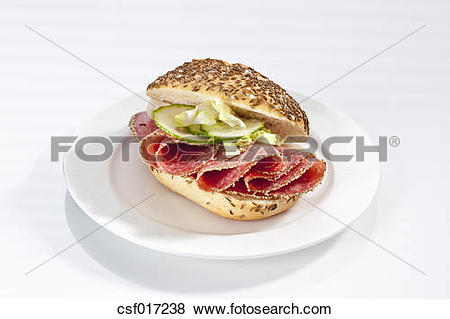 Pictures of Sandwich of caraway seed bread roll with pepper salami.