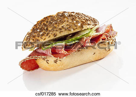 Stock Image of Sandwich of caraway seed bread roll with pepper.