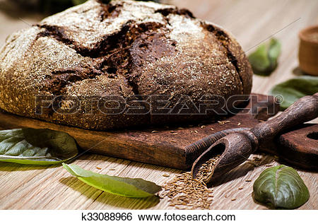 Stock Images of Round dark rye bread with caraway seeds and.