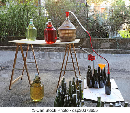 Stock Images of bottling and decanting of wine from the Carboy.