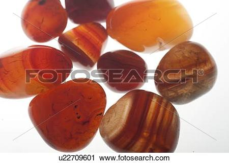 Stock Photography of Assortment of various red Gemstones including.