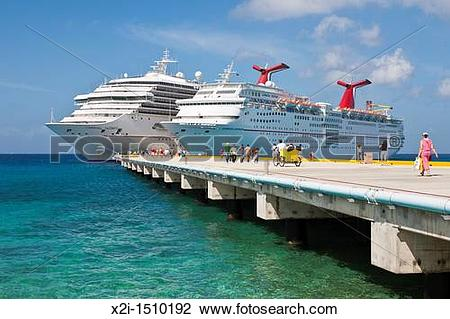 Stock Photo of Cruise ship passengers on pier disembarking from.