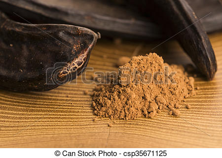 Stock Photo of carob pods and carob powder csp35671125.