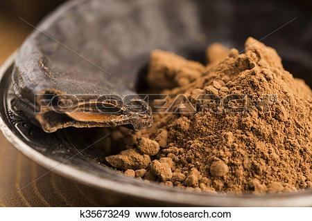 Stock Photograph of carob pods and carob powder k35673249.