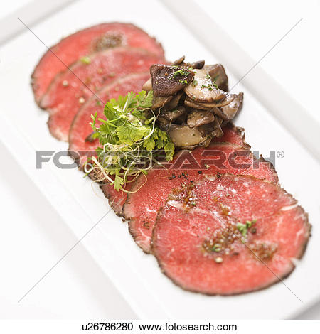 Stock Photography of Pepper charred beef carpaccio with mushrooms.