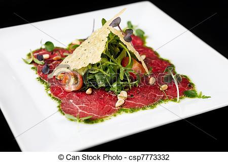 Stock Photo of Beef carpaccio on black background csp7773332.