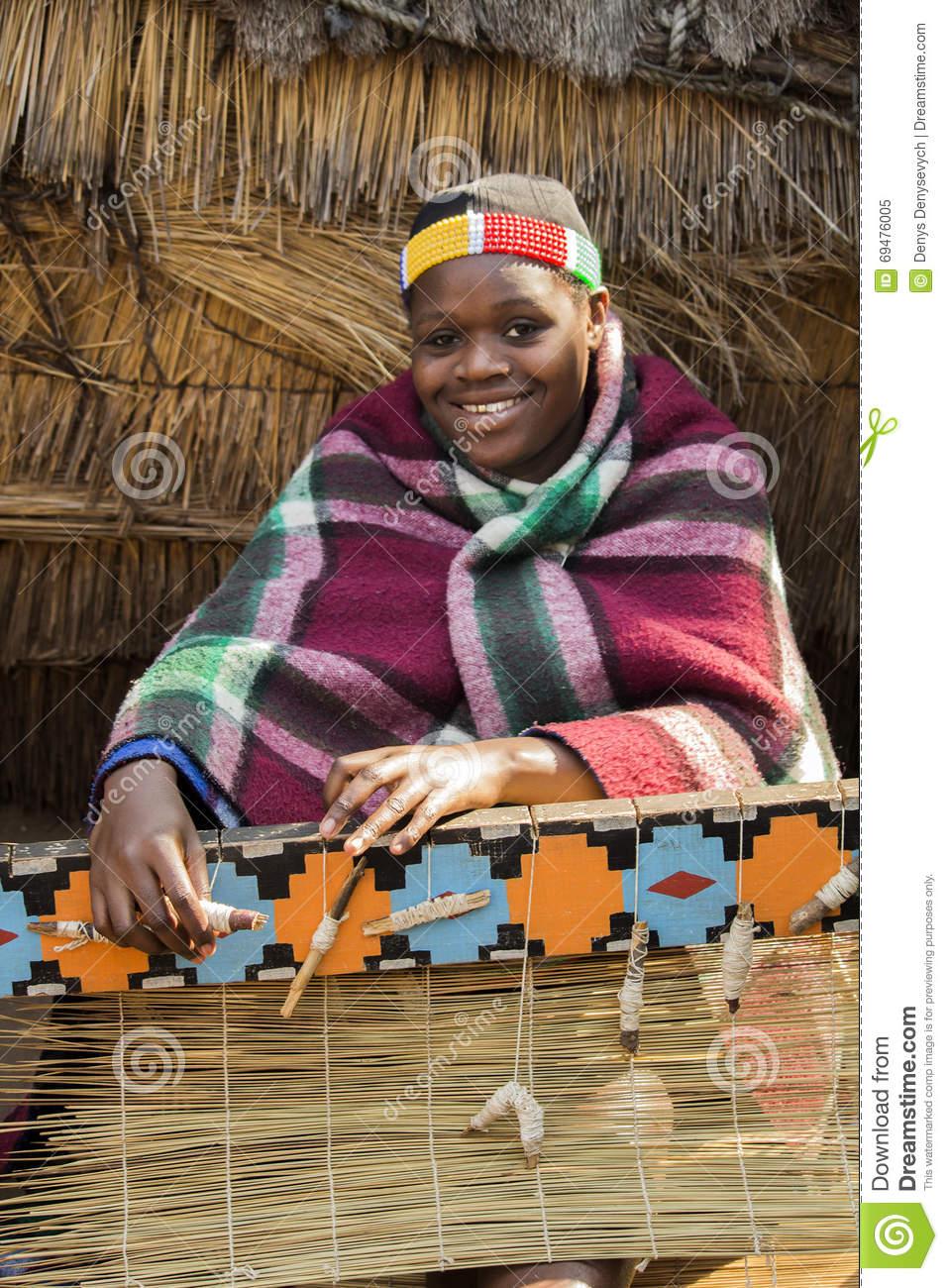 African Zulu Woman Weaves Straw Carpet. Editorial Image.