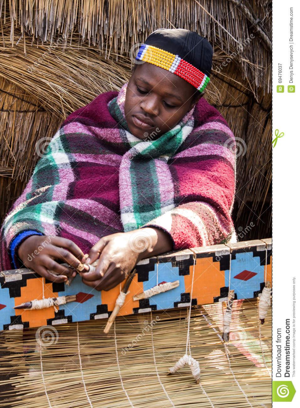 African Zulu Woman Weaves Straw Carpet. Editorial Photography.