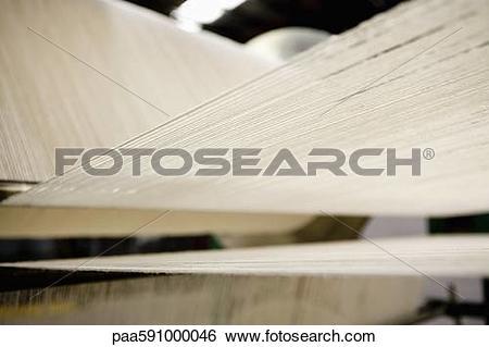 Stock Images of Carpet weaving loom in carpet tile factory.