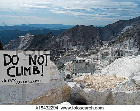 Stock Photo of Carrara marble quarries view and sign k15432294.