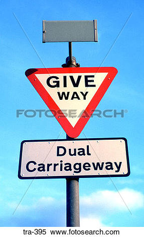 Stock Image of Give Way Sign and Dual Carriageway Notice tra.