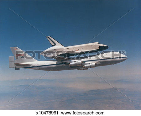 Stock Photography of Side profile of a jumbo jet carrying the.
