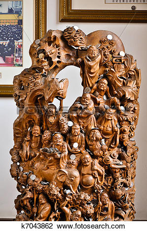 Stock Photo of fine carved wooden scene with buddhas and animals.