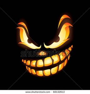 Clipart Picture: Scary Jack O Lantern Carved Face In the Dark.