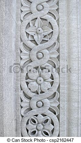 Picture of Floral pattern carved into a stone pillar.