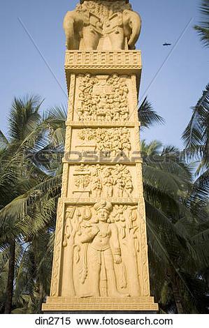 Stock Image of Carved statue on pillar at Buddhist Chaitya Bhumi.