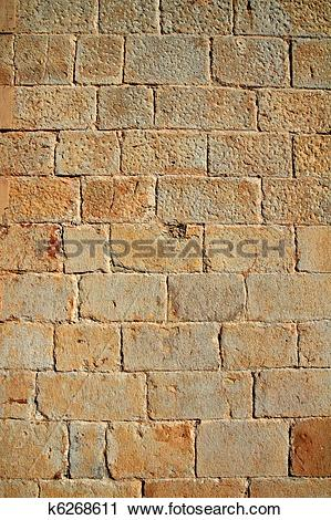 Stock Photography of Castle masonry wall carved stone rows pattern.
