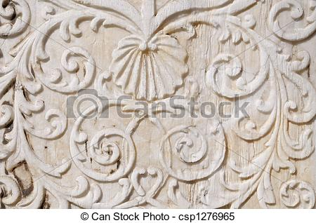 Stock Images of carved marble wall decoration.